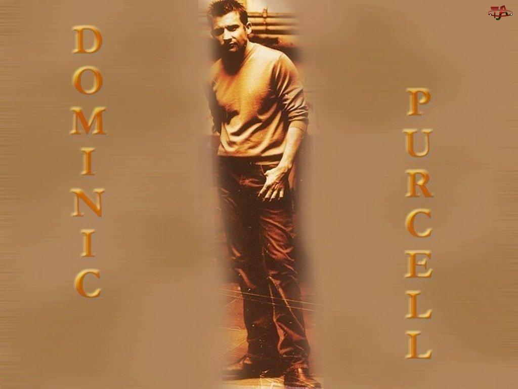 ciemne spodnie, Dominic Purcell, beżowa bluzka